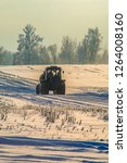 tractor in the winter field.   Shutterstock . vector #1264008160