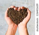 hands holding an earth heart   Shutterstock . vector #126401639