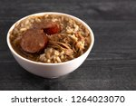 a bowl of sausage and chicken... | Shutterstock . vector #1264023070
