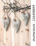 Three Textile Hearts On Wooden...