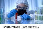 scientist in gas mask holding... | Shutterstock . vector #1264095919