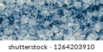 pieces of crushed ice cubes on... | Shutterstock . vector #1264203910