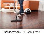 Attractive Female With Vacuum...