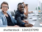 call center operators sitting... | Shutterstock . vector #1264237090