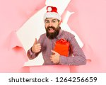 bearded man holds gift box and... | Shutterstock . vector #1264256659