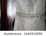 close up of wedding dress band | Shutterstock . vector #1264313590
