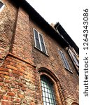 the facade of red brick. milan | Shutterstock . vector #1264343086