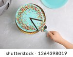 woman taking slice of fresh... | Shutterstock . vector #1264398019
