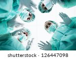 surgeons standing above of the... | Shutterstock . vector #126447098