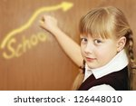 little schoolgirl is writing on ... | Shutterstock . vector #126448010