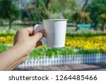 hand hold take away hot coffee... | Shutterstock . vector #1264485466