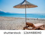 cane umbrellas and seabed  in a ... | Shutterstock . vector #1264488040