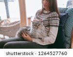 Young Girl In Sweater With Cat...