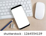 modern smartphone on a keyboard ... | Shutterstock . vector #1264554139
