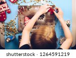girl made christmas decorations ... | Shutterstock . vector #1264591219