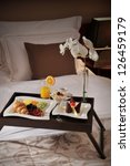 Stock photo breakfast in bed at a luxury hotel room 126459179