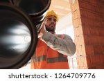 proud people working in... | Shutterstock . vector #1264709776