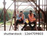 people working in construction... | Shutterstock . vector #1264709803