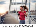 never give up.female running in ... | Shutterstock . vector #1264714669