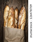 Four Baguette Bread Loaves In...