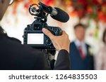 female videographer in backside ... | Shutterstock . vector #1264835503