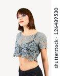 stunning female in knitted blue ... | Shutterstock . vector #126489530