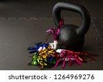 Black Kettlebell On A Black Gym ...