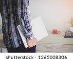 business man holding laptop... | Shutterstock . vector #1265008306
