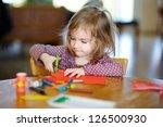 little preschooler girl cutting ... | Shutterstock . vector #126500930