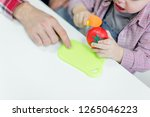 dad and toddler son having fun... | Shutterstock . vector #1265046223