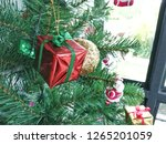 decorate a christmas tree on a... | Shutterstock . vector #1265201059