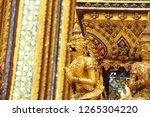 the golden garuda sculptures at ... | Shutterstock . vector #1265304220