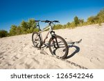 bicycle stands on sand | Shutterstock . vector #126542246