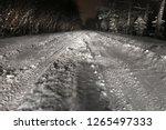 winter road at night. light of...   Shutterstock . vector #1265497333