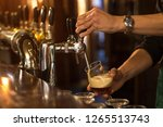 bartender pouring and filling... | Shutterstock . vector #1265513743