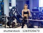 beautiful sporty fitness woman...   Shutterstock . vector #1265520673