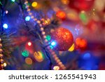 christmas tree in warm light... | Shutterstock . vector #1265541943