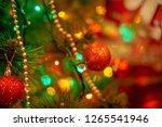 christmas tree in warm light... | Shutterstock . vector #1265541946