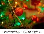 christmas tree in warm light... | Shutterstock . vector #1265541949