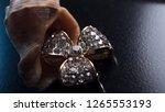 two golden sapphire earrings... | Shutterstock . vector #1265553193