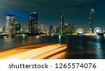 bangkok city at night through... | Shutterstock . vector #1265574076