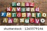 greeting card  feliz navidad y... | Shutterstock . vector #1265579146