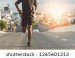 athlete runner feet running on... | Shutterstock . vector #1265601313