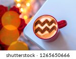 a cup of cappuccino coffee with ... | Shutterstock . vector #1265650666