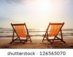 two deckchairs on the beach... | Shutterstock . vector #126565070