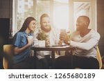 a company of friends sits in a...   Shutterstock . vector #1265680189