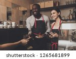 team of male and female barista ... | Shutterstock . vector #1265681899