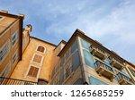 small town narrow street view... | Shutterstock . vector #1265685259