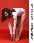 beautiful girl in swimsuit...   Shutterstock . vector #1265701636