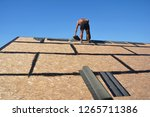 roofing construction with... | Shutterstock . vector #1265711386